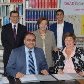 The Kassem family signing the donation agreement with the DAAD-Stiftung